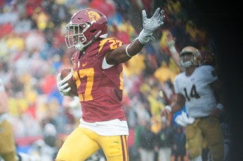 Trojans redshirt sophomore defensive back Ajene Harris celebrates an interception, which he returned for a touchdown, during USC's 45-27 win over Notre Dame on Saturday.