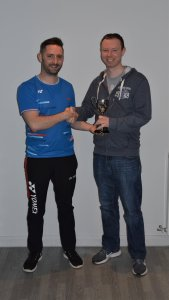 League Chair, Steven Chappell presenting the Men's Division 2 trophy to Steven Plank from Racquets B
