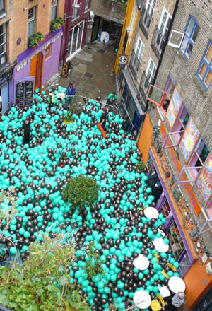 Balloons fill Neal's Yard as part of an ad campaign