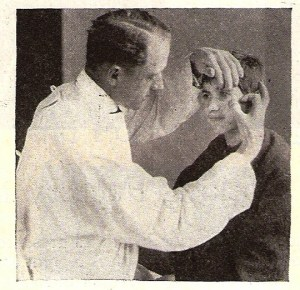 Dr. R.T. Uhls attending to a trachoma patient at Alexandropol. Near East Relief started a trachoma hospital at Seversky Post Orphanage to combat the virulent eye disease, which often led to blindness if left untreated.