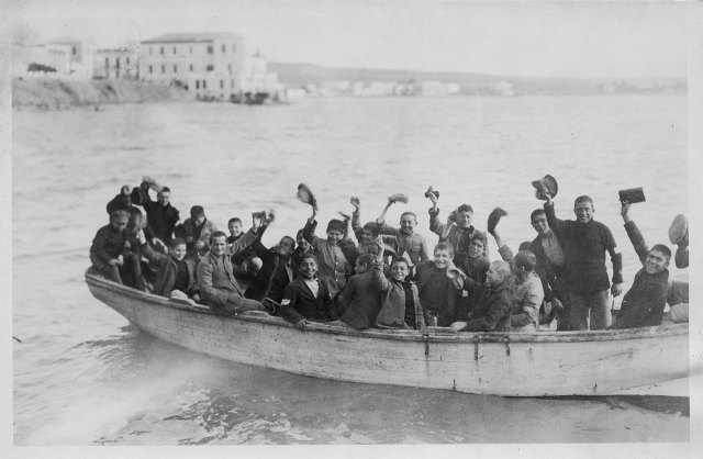 Boys in a Near East Relief boat, probably Greece. Based on their age, the boys may be graduating from the orphanage.