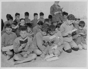Young boys attend a class outside