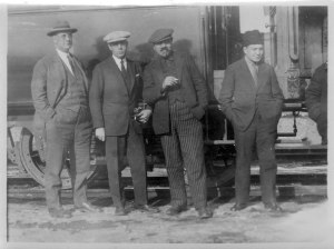 Ernest Yarrow (left) standing in front of a train car with three unidentified men. Yarrow was the director of Near East Relief in the Caucasus region.