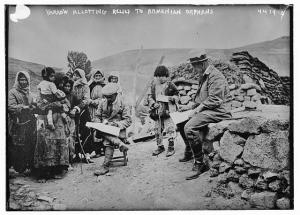 Near East Relief worker Ernest Yarrow distributes supplies to widows and children in the Caucasus, where he was the Director of relief operations.