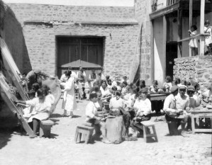 Boys and girls in an outdoor workshop