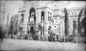 Large group of men in front of a building
