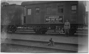 E.A. Yarrow, NER's director in the Caucasus region, with a Near East Relief train car. Yarrow traveled frequently from his office in Tiflis to relief stations throughout the region. He was very fond of his dog, who appears in many pictures.