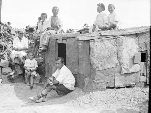 Boys sit on the roof of a small house that they built themselves at Polygon Orphanage in Alexandropol.
