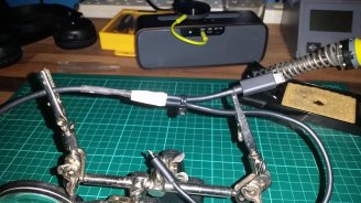 Wrapped in heatshrink and electrical tape for strength and the two output cables cable tied.