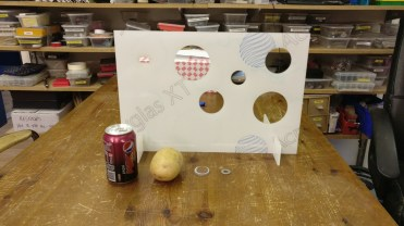 The size of the backboard and targets with a can of coke, potato and pennies for scale.