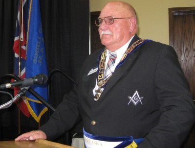R.W. Grand Junior Warden Bob Moninger brings greetings during the Annual Communication