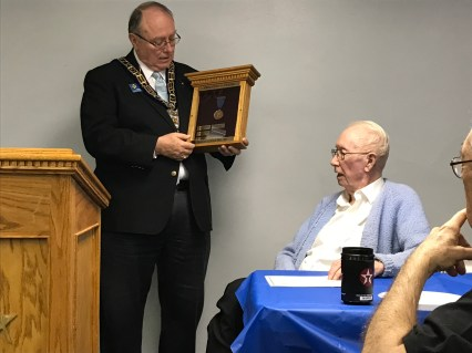 Grand Master Rick Myers is shown making up stories about the many years of service provided by MW Charles Amidon.