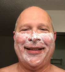 Senior Warden Dennis Bostow of North Bend 119 applies sun screen for the next day of the GM's road trip. His teeth got burned.