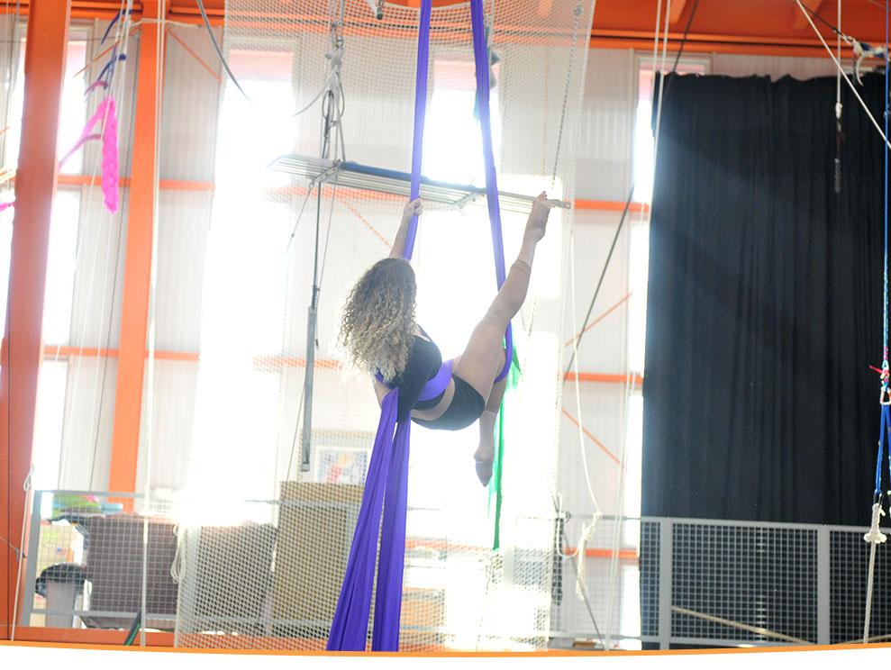 photo of a woman performing on aerial fabric