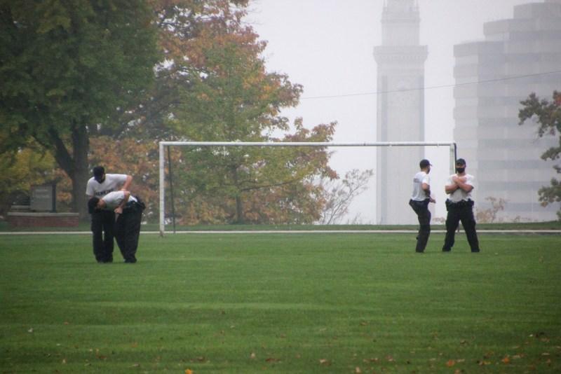 Aspiring cops practicing on quad