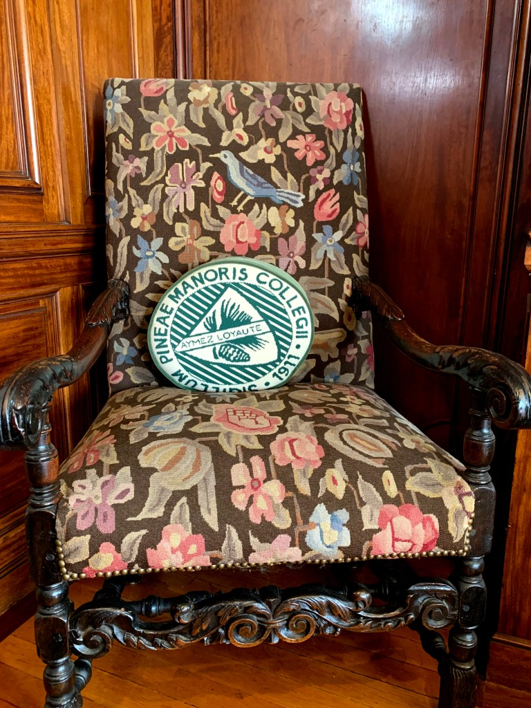 Pine Manor cushion on chair