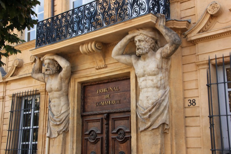 Two Atlas figures holding up balcony