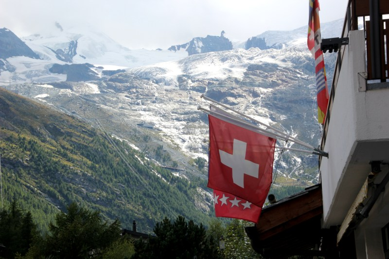 Swiss flag hanging off building