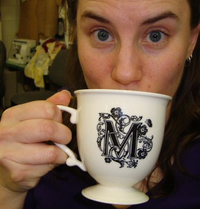 Cosette kicks it with a fancy mug of coffee