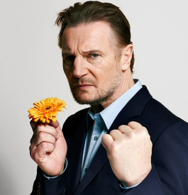 Liam Neeson with flower