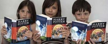 Three kids reading Harry Potter