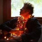 Tom Waits wearing Christmas lights