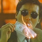 Chow Yun Fat lighting a cigarette with burning money