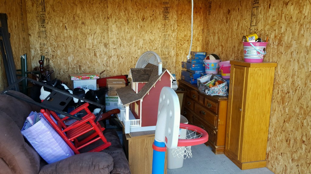 dresser couch rocking chair basketball hoop sand buckets legos doll house in storage unit