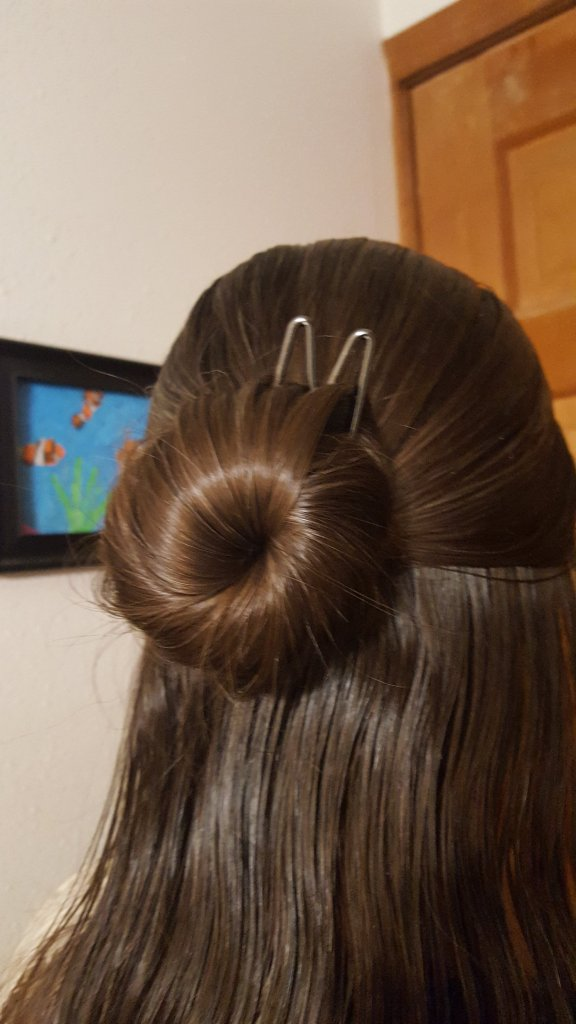 woman with brown hair wearing a bun with a Lilla Rose Fox Upin