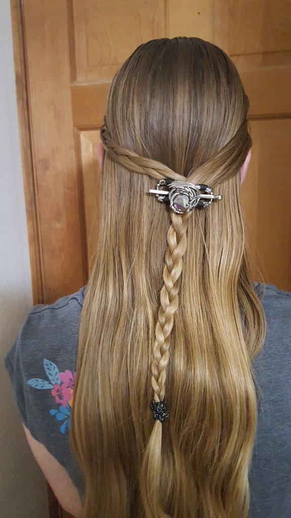 dragon hair clip above a braid on a long haired teenage girl