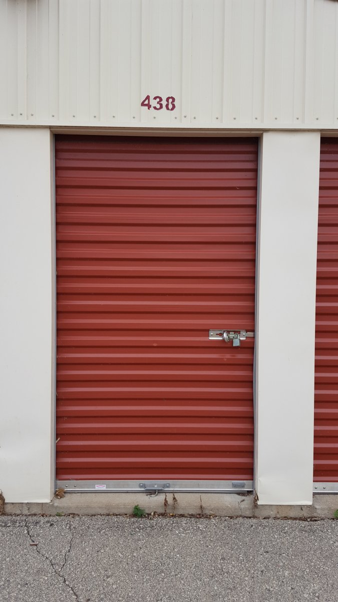 closed door to a storage locker with the lock on it