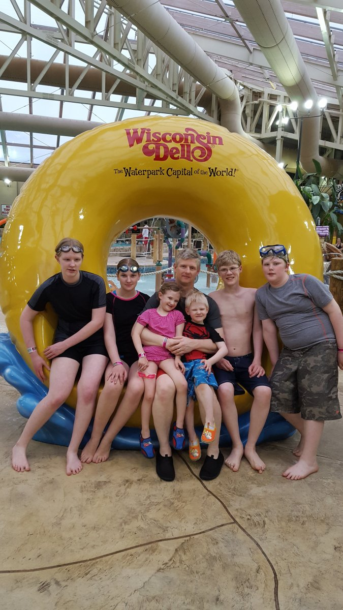large family posing for a picture at an indoor waterpark