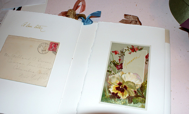 scrapbook with envelope postage romance card DIY Ideas For An Amazing Family Scrapbook
