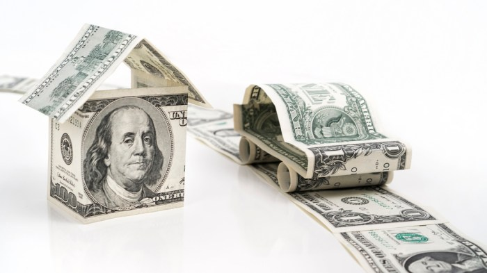 american dollars folded into a house, car and street spend less on insurance