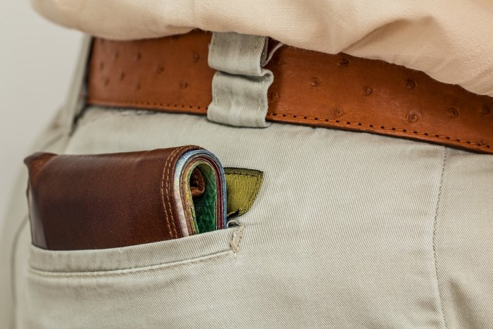 wallet in man's pocket The Personal Finance Guide That Could Change Your Life