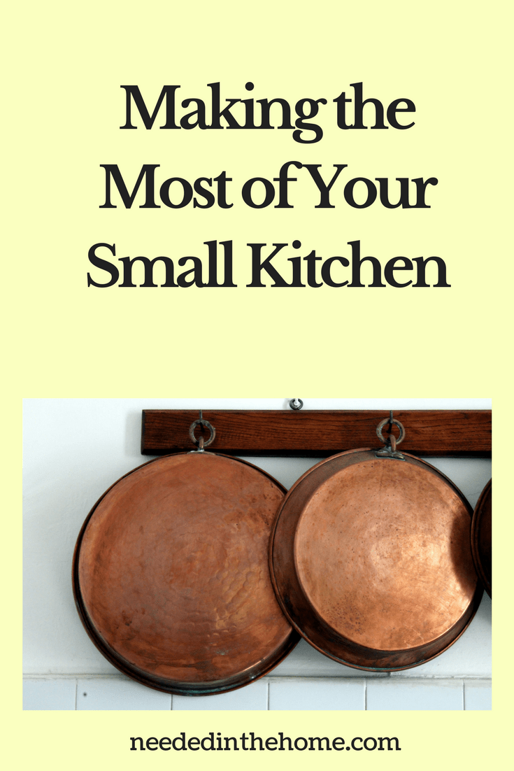 copper pans hanging from hooks in the kitchen Making the Most of Your Small Kitchen neededinthehome.com