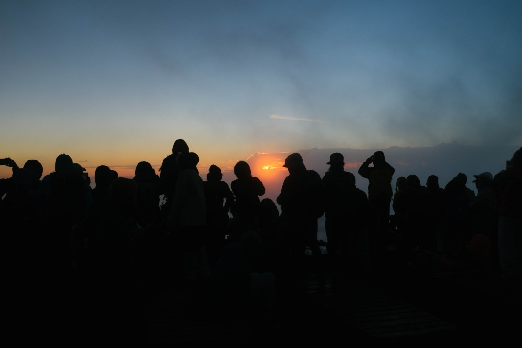 Awaiting the sunrise atop Mt. Fuji.