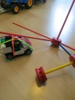 A crane made from TinkerToy, string from a threading card to pull up a Lego car - love it