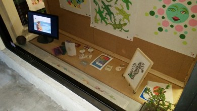 Front window display, with framed zebra and slideshow monitor