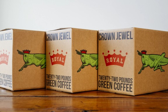 A trio of Royal Coffee Crown Jewel boxes showcasing the refreshed identity