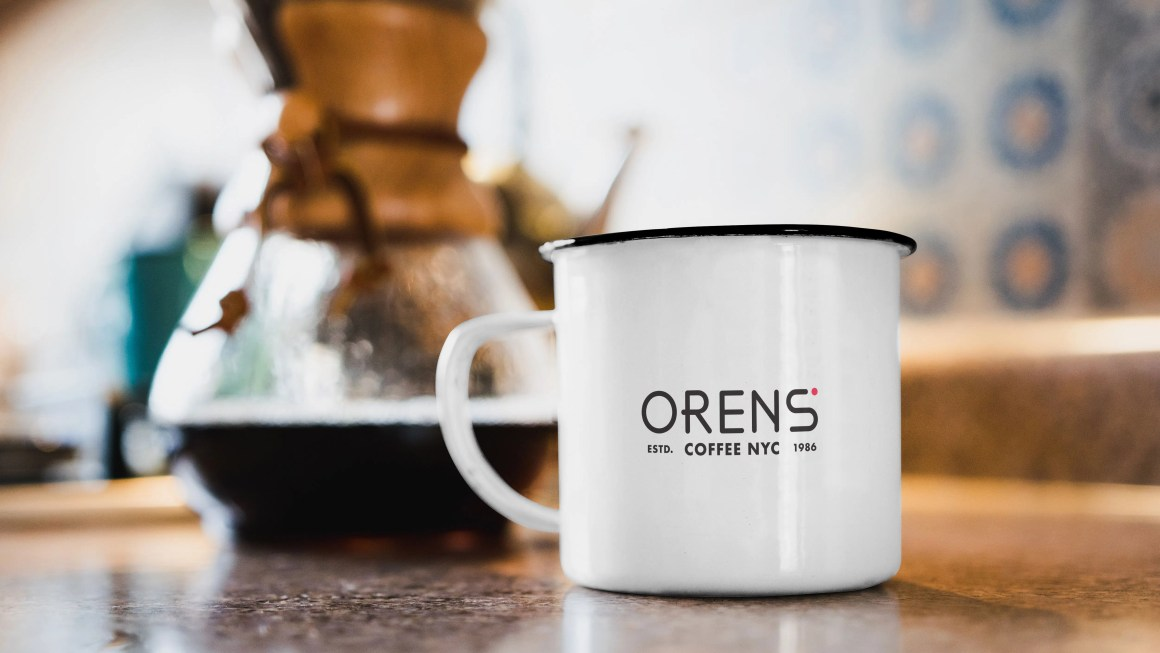 orens logo on a mug with coffee brewing