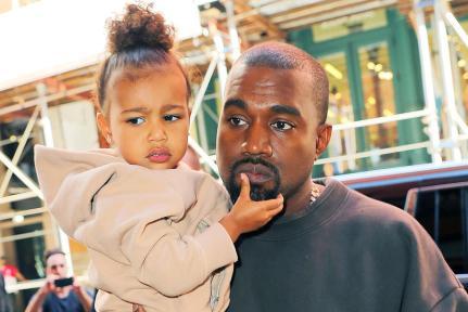 16 Sep 2015, New York State, USA --- Kim Kardashian, Kanye West, North West depart their fashion show in NYC Pictured: Kim Kardashian, Kanye West, North West --- Image by © XactpiX/splash/Splash News/Corbis