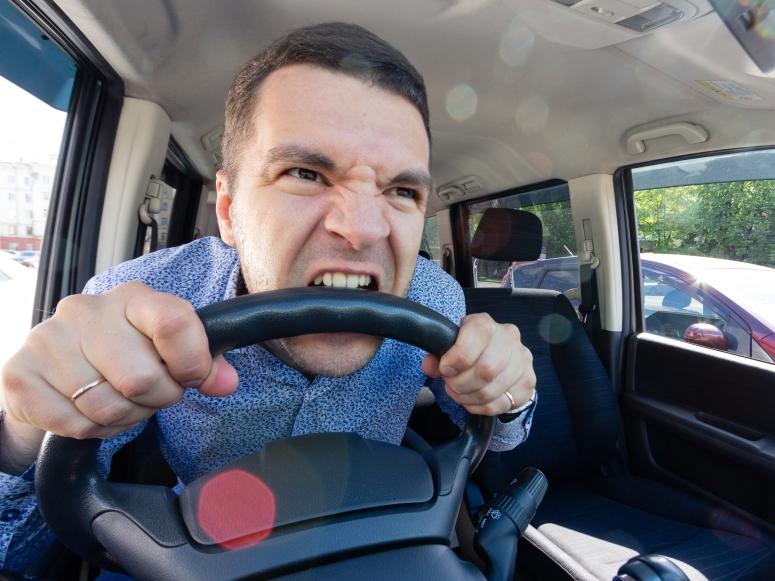 Man biting wheel