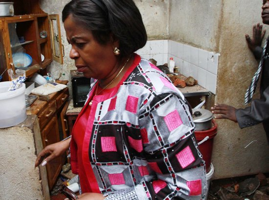 Home Affairs Minister Theresa Makone inspecting a Mbare home destroyed by Zanu PF thugs