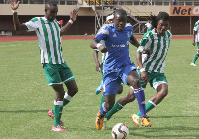 Dynamos wingback, Godknows Murwira, streaks clear of three CAPS United players (from left) Ronald Pfumbidzai, Moses Mucheche and George Nyirenda during the Harare Derby at the National Sports Stadium