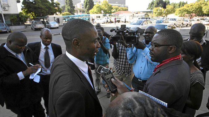 Jealousy Mawarire being interviewed by journalists