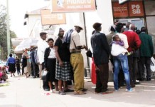 Pensioners queue to withdraw their cash at a Bulawayo bank yesterday