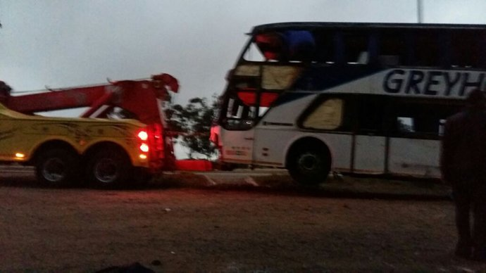 The Greyhound Bus being towed away