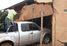 Delani Ngwenya's Ford Ranger in the wall of his family home in Siyanungu Village, Gokwe South