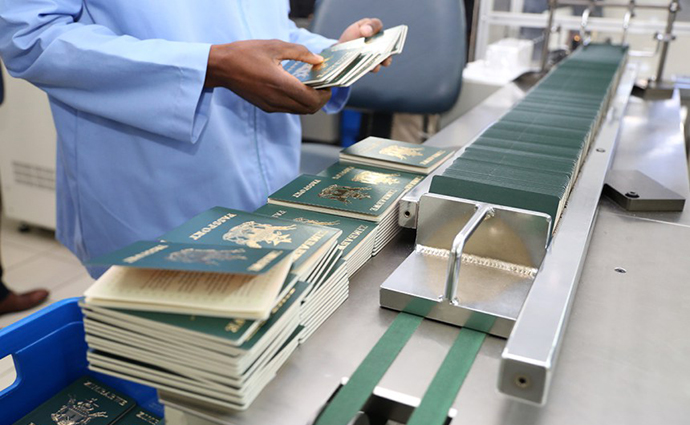 Passports go through the numbering and perforation stage at the National Passport Production Centre in Harare